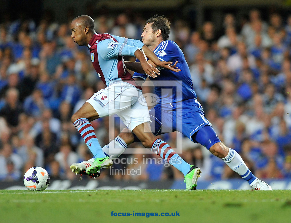 Picture by Alan Stanford/Focus Images Ltd +44 7915 056117<br /> 21/08/2013<br /> Fabian Delph of Aston Villa takes on Frank Lampard of Chelsea during the Barclays Premier League match at Stamford Bridge, London.