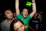 ENGLISH CLUBBER ARMS RAISED WIDEYED TOWARDS CAMERA