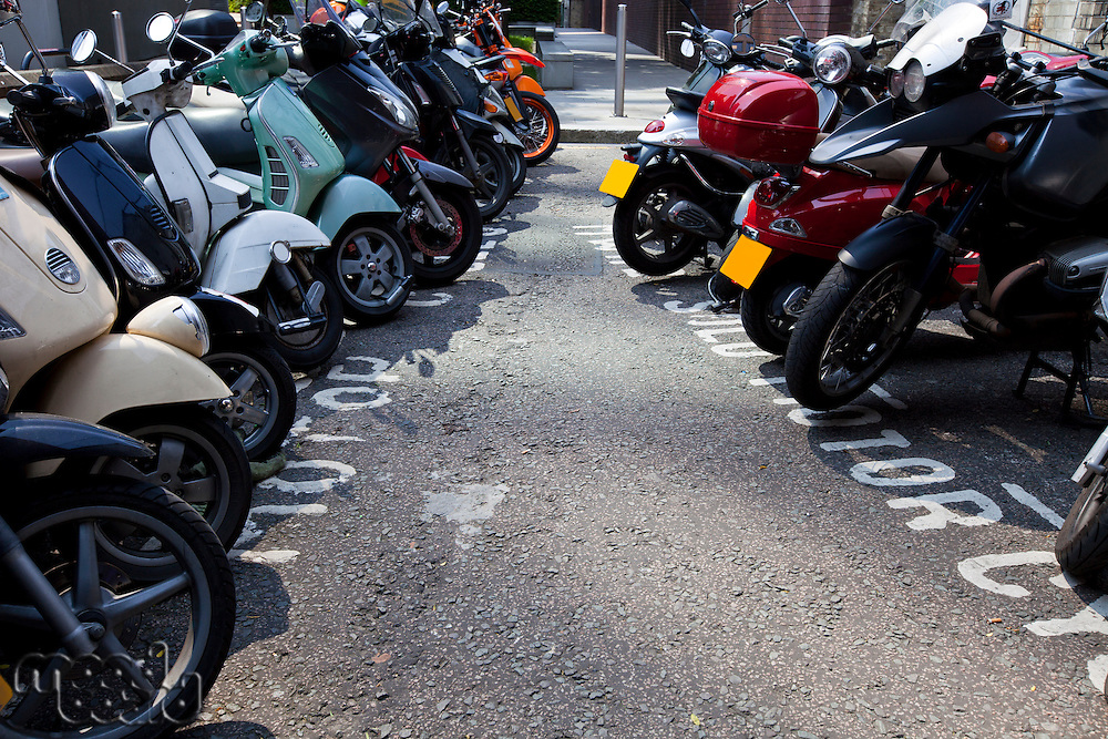 Motor bikes parked in a row