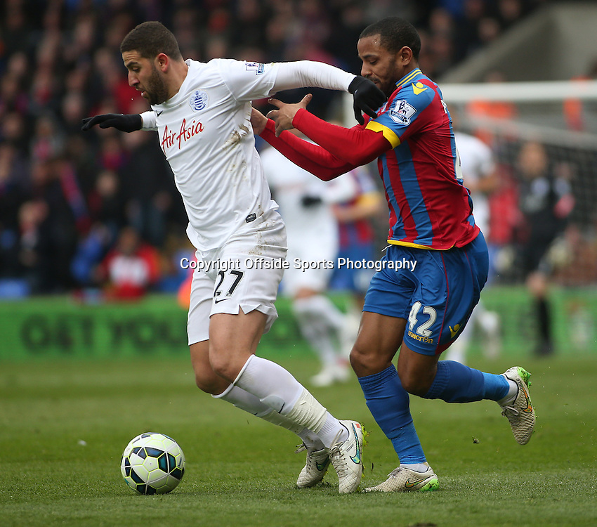 14 March 2015 - Barclays Premier League - Crystal Palace v Queens Park Rangers - Adel Taarabt of QPR is chased by Jason Puncheon of Palace.<br /> <br /> Photo: Ryan Smyth/Offside