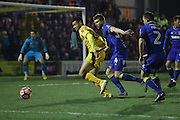 AFC Wimbledon defender Chris Robertson (34) chases Sutton United Maxime Biamou (24) during the The FA Cup third round replay match between AFC Wimbledon and Sutton United at the Cherry Red Records Stadium, Kingston, England on 17 January 2017. Photo by Stuart Butcher.