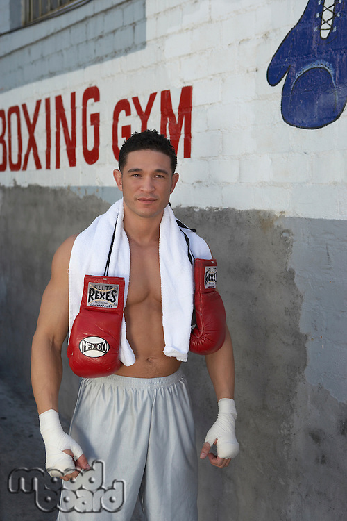 Portrait of male boxer outside gym