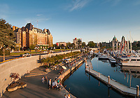 The Inner Harbour of Victoria is glorious and warm on a sunny spring evening as people stroll by the waterfront and the Empress Hotel.