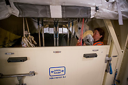 Bertram Allen's, (IRL), Molly Malone V in her flying stall next to Pius Schwizer's Toulago<br /> Departure of the horses to the World Cup Finals in Las Vegas from Schiphol - Amsterdam 2015.<br />  © Hippo Foto - Dirk Caremans