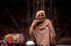KATHMANDU, NEPAL - OCTOBER 1992 - A homeless man panhandles in Kathmandu. (PHOTO © JOCK FISTICK)