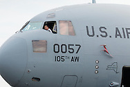 New Windsor, New York - A man checks out the cockpit of a C-17 Globemaster II on display at the New York Air Show at Stewart International Airport on Aug. 30, 2015.