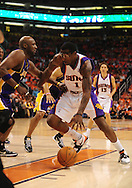 May 23, 2010; Phoenix, AZ, USA; Phoenix Suns forward Amare Stoudemire (1) drives the ball against Los Angeles Lakers forward Lamar Odom (7) during the first half in game three of the western conference finals in the 2010 NBA Playoffs at US Airways Center.  Mandatory Credit: Jennifer Stewart-US PRESSWIRE
