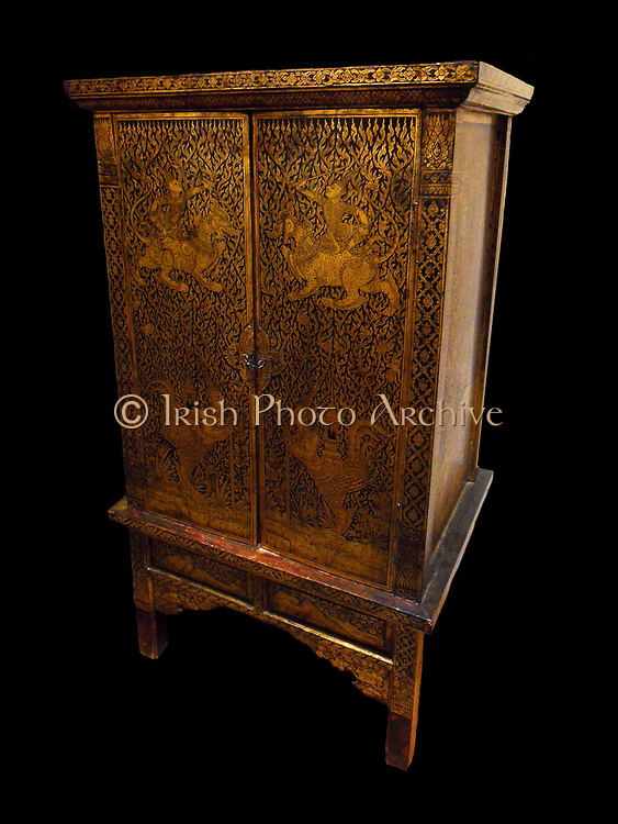 Writing desk or cabinet, mid 19th century from Thailand (Siam), Chakri dynasty (Ratanakosin Era) (1782-20th century). Made from gilded, lacquer on teak