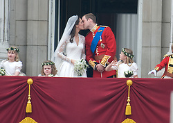 Prince William, Duke of Cambridge and Catherine, Duchess of Cambridge kiss on the balcony at Buckingham Palace in London, England following their wedding at Westminster Abbey on April 29, 2011