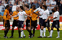 Photo. Jed Wee, Digitalsport<br /> NORWAY ONLY<br /> <br /> Wolverhampton Wanderers v Tottenham Hotspurs, FA Barclaycard Premiership, 15/05/2004.<br /> Wolves' Paul Ince (L) signs out from the Premiership amidst more controversy as he is sent off for a second yellow card for bringing down Spurs' Jamie Redknapp (R), but refusing to leave the pitch as the two players try to square up to each other.