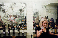 2 December, 2008. New York, NY. Stephanie Mannat, assistant manager at the Tinto Fino wine shop, tastes a glass of sherry. The Tinto Fino spanish wine shop organizes a sherry tasting. Sherry is a fortified wine made from white grapes that are grown near the town of Jerez, Spain. In Spanish, it is called Vino de Jerez.<br /> <br /> ©2008 Gianni Cipriano for The New York Times<br /> cell. +1 646 465 2168 (USA)<br /> cell. +1 328 567 7923 (Italy)<br /> gianni@giannicipriano.com<br /> www.giannicipriano.com