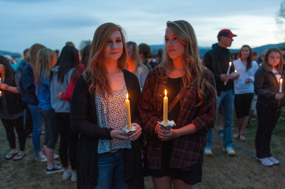 Hannah Clouse, on left, and Hannah Holland, on right, both students at Big Sky High School, attend the vigil for slain German exchange student, Diren Dede, on May 2, 2014, at the Fort Missoula soccer field where Dede had played.