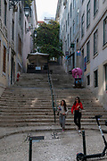 Stairs in a steep narrow alley in Baixa, Lisbon, Portugal
