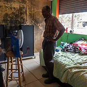 SEPTEMBER 25 - LOIZA, PUERTO RICO - <br /> Santiago Qui&ntilde;ones Escalera, 73, next to an air mattress he and his wife are sleeping in these days in the coastal area of Pi&ntilde;ones in Loiza which sustained heavy damage by the destructive path of Hurricane Maria. Qui&ntilde;ones owns the bar/restaurant in front of the ocean and he decided he and his wife should ride the storm out there. Fortunately the building held up. They use a generator and solar powered lighting.<br /> (Photo by Angel Valentin for NPR)