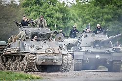 "Various tank crews watch a display on the course at the Tank Museum, Bovington, as the attraction hosts ""Tiger Day"" to mark the 75th anniversary of the world's only working Tiger Tank's capture in 1943 in the Tunisian desert."