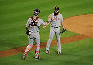 June 14 2011; Phoenix, AZ, USA; San Francisco Giants closing pitcher .Brian Wilson (38) is congratulated by catcher Chris Stewart (37) after the ninth inning against the Arizona Diamondbacks at Chase Field. The Giants defeated the Diamondbacks 6-5.  Mandatory Credit: Jennifer Stewart-US PRESSWIRE..