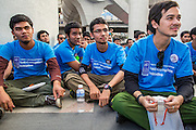 09 DECEMBER 2012 - BANGKOK, THAILAND:   Thai college students listen to speakers at the Bangkok Art and Culture Centre (BACC) during an anti-corruption rally. About 1,500 Thai university students from 90 universities across Thailand attended the rally. The latest Corruption Perceptions Index survey by Transparency International listed Thailand at number 88 out of 176 countries surveyed. The level of corruption in Thailand is perceived to be on the same par as Malawi, Swaziland and Zambia. Thailand's ranking slipped from 80 last year. A series of surveys show that Thais increasingly view corruption as acceptable. A recent ABAC (Assumption Business Administration College, the forerunner to Assumption University, one of the most respected private universities in Thailand) poll reported that a majority (63 per cent) of Thai people hold the view that corruption in government is acceptable as long as they also benefit from it. A majority of young people under 20 now hold the same attitude. International Anti-Corruption Day has been observed annually, on the 9th December, since the passage of the United Nations Convention Against Corruption on 31 October 2003.      PHOTO BY JACK KURTZ