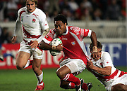 Sukanaivalu Hufanga powers past Olly Barkley to score the opening try for Tonga. England v Tonga, Parc Des Princes, Paris, France, 28th Septemeber 2007. Rugby World Cup 2007.