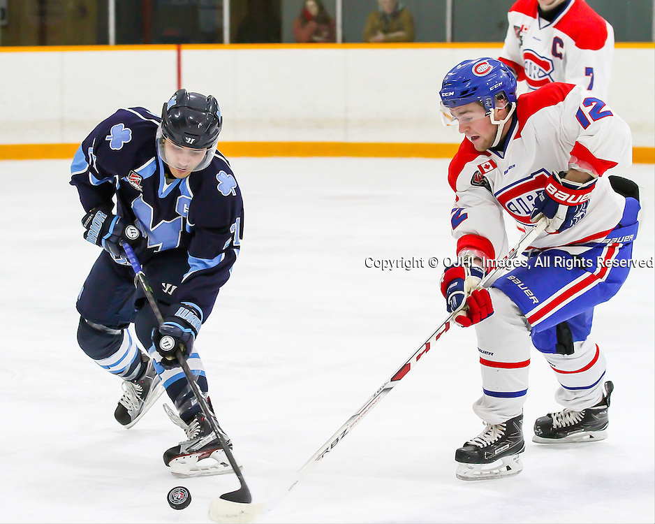 TRENTON, ON - JAN 25,  2017: Ontario Junior Hockey League game between St Michaels and Toronto Junior Canadiens at the 2017 Winter Showcase, A.J. D'Orazio #21 of the St. Michael's Buzzers skates with the puck while being pursued by Jeremy Smith #12 of the Toronto Jr. Canadiens during the first period.<br /> (Photo by Ray MacAloney / OJHL Images)