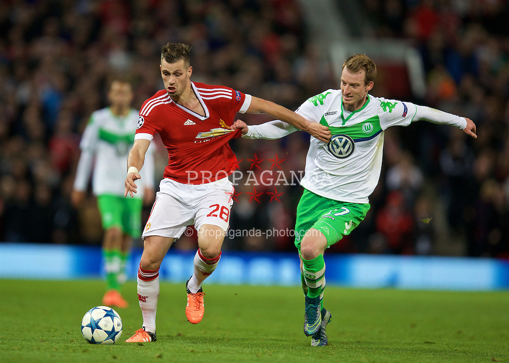 MANCHESTER, ENGLAND - Wednesday, September 30, 2015: Manchester United's Morgan Schneiderlin in action against VfL Wolfsburg's Maximilian Arnold during the UEFA Champions League Group B match at Old Trafford. (Pic by David Rawcliffe/Propaganda)