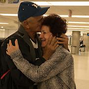 Pedro Ravelo of Cuba is greeted by  close friend Irene Heredia after he arrived at Miami airport, Florida, U.S. February 23, 2018. Picture taken February 23, 2018.  REUTERS/Angel Valentin