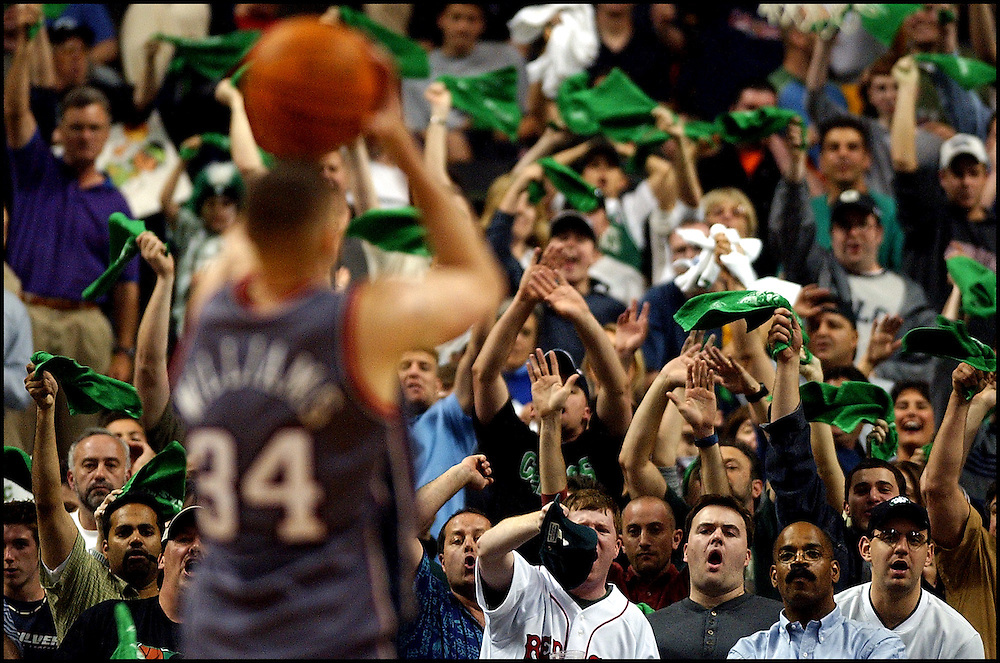 (5/25/02 -Boston, MA)  Boston Celtics vs New Jersey Nets. Game #3  . Celtics fans wave rally towels as Aaron Williams attepts a free throw in the 4th Q. (052502celticsmjs-Staff Photo by Michael Seamans . Saved in FTP)