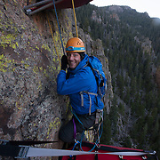 Jonathan Thompson is relieved to descend to terra firma after a sleepless night of cliff camping in Estes Park, CO