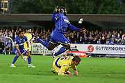 Bayo Akinfenwa forward for AFC Wimbledon (10) jumps a challenge during Sky Bet League 2 Play-Off first leg match between AFC Wimbledon and Accrington Stanley at the Cherry Red Records Stadium, Kingston, England on 14 May 2016. Photo by Stuart Butcher.