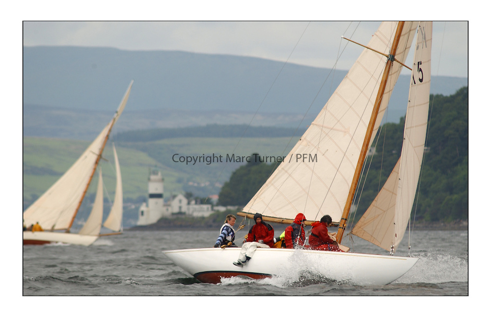 Sunshine, a 6 metre built in 1929, sailed by Helen Sandiford and an all girl crew. off the Cloch Lighthouse with Tern in the Background...This the largest gathering of classic yachts designed by William Fife returned to their birth place on the Clyde to participate in the 2nd Fife Regatta. 22 Yachts from around the world participated in the event which honoured the skills of Yacht Designer Wm Fife, and his yard in Fairlie, Scotland...FAO Picture Desk..Marc Turner / PFM Pictures
