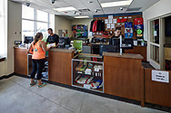 A customer makes a purchase at the Outdoor UW office in the lower level of Memorial Union. This space reopened in 2014 after the Memorial Union Reinvestment.