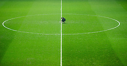 SWANSEA, WALES - Wednesday, January 23, 2013: A groundsman marks out the lines at Swansea City's Liberty Stadium as snow falls before the Football League Cup Semi-Final 2nd Leg match against Chelsea. (Pic by David Rawcliffe/Propaganda)