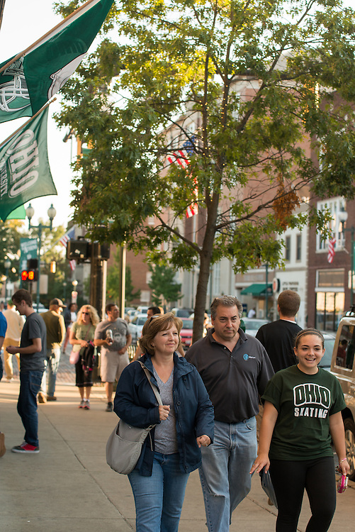 Parents enjoy the company of their family while walking around Court Street on Saturday evening Sept. 21, 2013. © Ohio University / Photo by Elizabeth Held