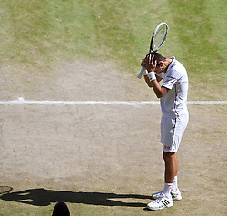 LONDON, ENGLAND - Friday, July 4, 2014: Novak Djokovic (SRB) looks dejected during the Gentlemen's Singles Semi-Final match on day eleven of the Wimbledon Lawn Tennis Championships at the All England Lawn Tennis and Croquet Club. (Pic by David Rawcliffe/Propaganda)