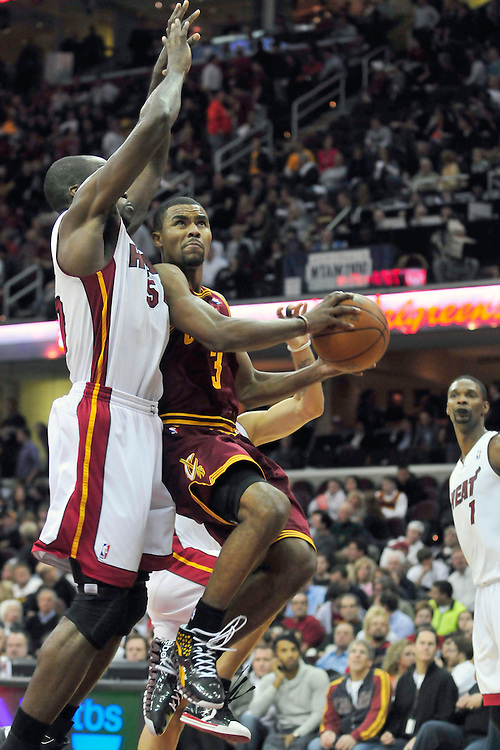 Dec. 2, 2010; Cleveland, OH, USA;  Miami Heat center Joel Anthony (50) tries to stop Cleveland Cavaliers point guard Ramon Sessions (3) during the third quarter at Quicken Loans Arena. The Heat beat the Cavaliers 118-90. Mandatory Credit: Jason Miller-US PRESSWIRE