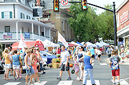 Pedestrians walk through the intersection of State and Main Streets during Doylestown Arts Fest  September 10, 2016 in Doylestown, Pennsylvania.  (Photo by William Thomas Cain)