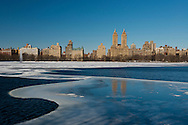 The towers of the El Dorado building on Central Park West reflected on the frozen Jacqueline Kenndy Onasis Reservoir in Central Park, Manhattan, New York City, New York State, U.S.A.