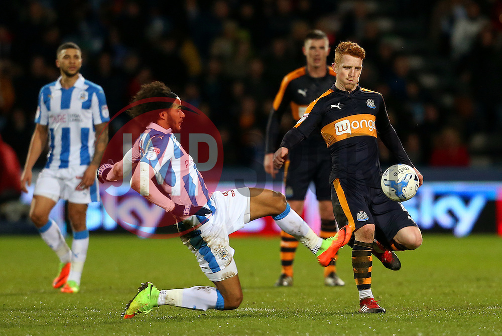 Isaiah Brown of Huddersfield Town tackles Jack Colback of Newcastle United - Mandatory by-line: Matt McNulty/JMP - 04/03/2017 - FOOTBALL - The John Smith's Stadium - Huddersfield, England - Huddersfield Town v Newcastle United - Sky Bet Championship