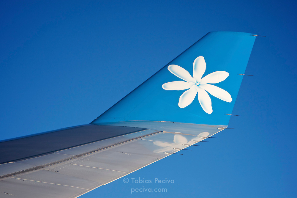 Image of a Tahitian gardenia on the winglet of an Air Tahiti Nui airliner. This fragrant flower holds a prominent position in Tahitian culture.