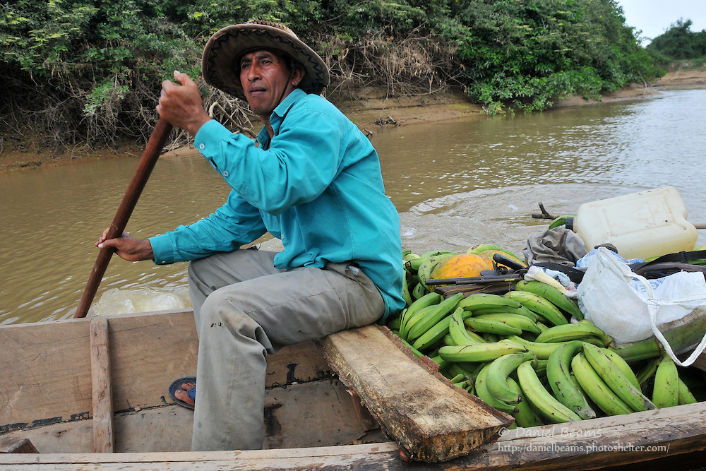 Transporting cargo on the Secure River in the Isiboro-Secure national park, Beni, Bolivia
