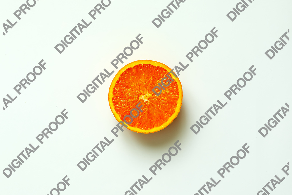 Orange fruit. Orange half fruit sliced isolate on white background seen from above flatlay style, close up.