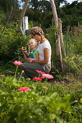 A woman and her young daughter in a community garden in Glouceseter, Massachuetts.