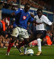 Fotball<br /> Premier League England 2004/2005<br /> 18.10.2004<br /> Foto: SBI/Digitalsport<br /> NORWAY ONLY<br /> <br /> Portsmouth v Tottenham Hotspur<br /> <br /> Portsmouth's Lua Lua and Spurs' Atouba