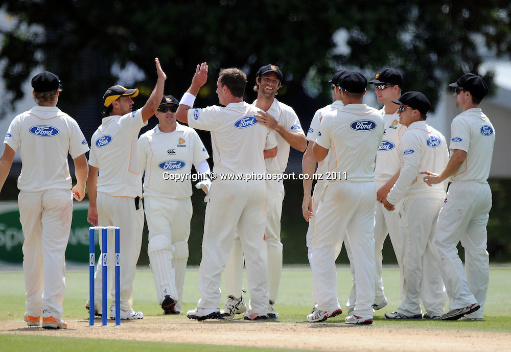 Wellington's Mark Gillespie and team mates celebrate during the Ford Trophy Cricket match between Auckland and Wellinton at Colin Maiden Oval in Auckland, New Zealand on Monday 27 February 2012. Photo: Andrew Cornaga/Photosport.co.nz