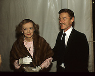 Betty Davis and Roddy McDowell arrive at the 20th Century Fox dinner during the visit of Queen Elizabeth II to California in March 1983...Photograph by Dennis Brack bb23