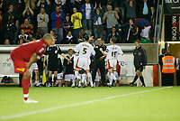 Photo: Marc Atkins.<br /> Milton Keynes Dons v Colchester United. Carling Cup. 22/08/2006. Izale McLeod celebrates with teamates on the bench after scoring for MK Don's