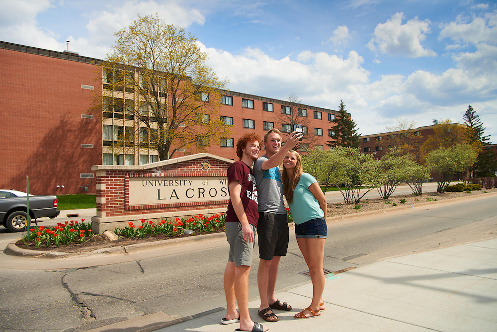 Activity; Playing; Socializing; Buildings; Cleary; Laux Hall; Location; Outside; Objects; Phone Cell Smartphone iPhone; People; Student Students; Woman Women; Man Men; Spring; April; Time/Weather; sunny; Type of Photography; Candid; UWL UW-L UW-La Crosse University of Wisconsin-La Crosse
