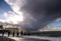 © Licensed to London News Pictures.04/03/2019.  Aberystwyth, UK. Dramatic storm and rain clouds over Cardigan Bay off the coast of Wales at Aberystwyth  on a blustery and cold day in the aftermath of Storm Freya. The weather for the week ahead is unsettled, with the threat of wintery snow and sleet showers. Photo credit: Keith Morris/LNP