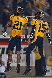 BERKELEY, CA - OCTOBER 06: Wide receiver Keenan Allen #21 of the California Golden Bears celebrates with quarterback Zach Maynard #15 after scoring a touchdown against the UCLA Bruins during the third quarter at California Memorial Stadium on October 6, 2012 in Berkeley, California. The California Golden Bears defeated the UCLA Bruins 43-17. (Photo by Jason O. Watson/Getty Images) *** Local Caption *** Keenan Allen; Zach Maynard