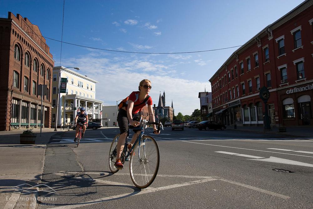 Biking on Main Street in St Johnsbury Vermont USA (MR)