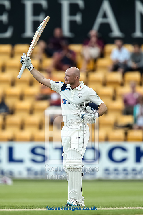 Adam Lyth of Yorkshire County Cricket Club acknowledges the applause on reaching his century during the LV County Championship Div One match at the County Ground, Northampton, Northampton<br /> Picture by Andy Kearns/Focus Images Ltd 0781 864 4264<br /> 01/06/2014